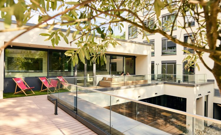 Bright vitality terrace with wellness area and whirlpool.