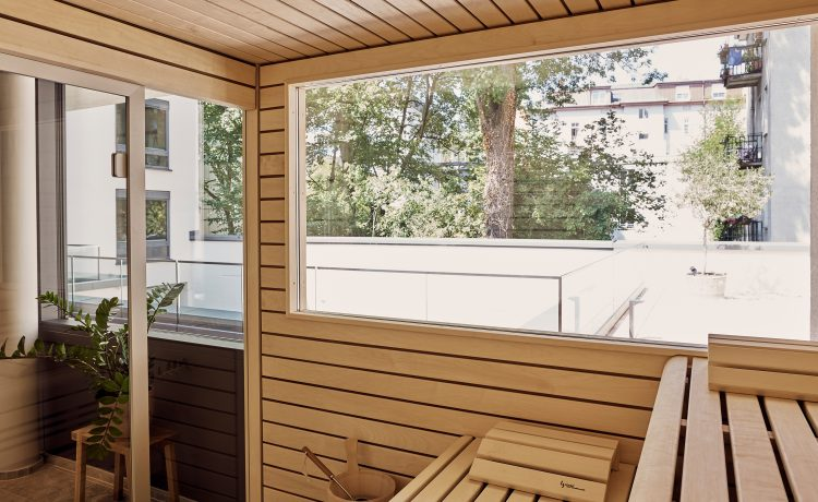 Bright and light-flooded sauna area with large viewing window.