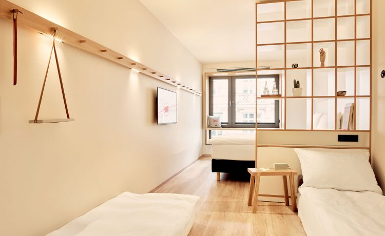 Bright and spacious room with room divider shelf and large windows.