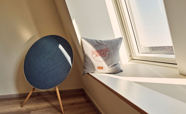 Windowsill with slanted window and cushions in suite 63.